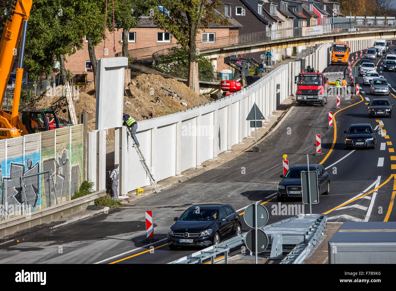 Construction of a noise barrier wall, along a highway, Autobahn A40, in Essen, Germany - Stock Image