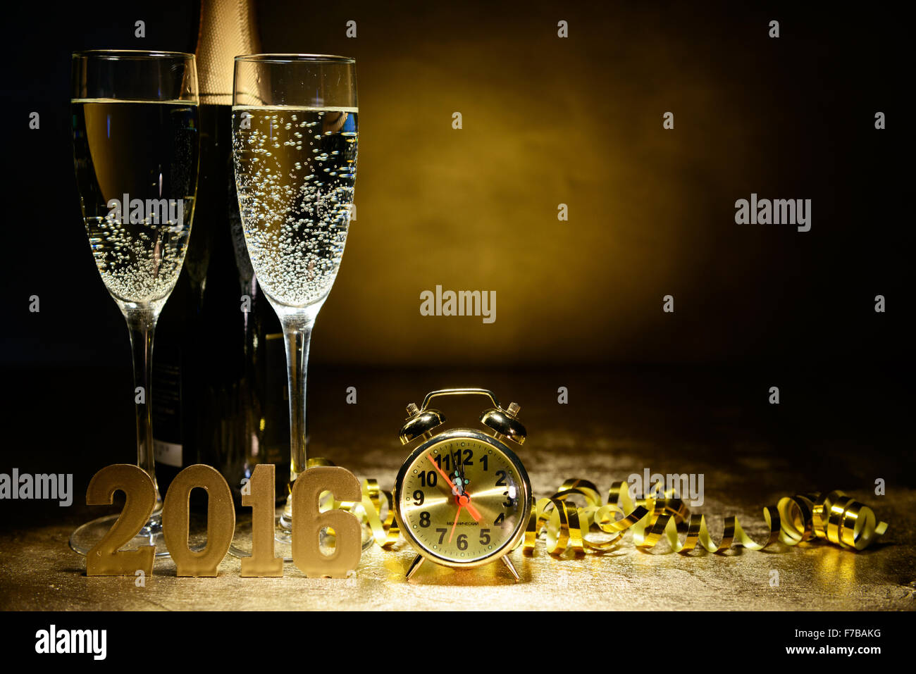 two glasses of champagne on a gold background christmas and new year theme