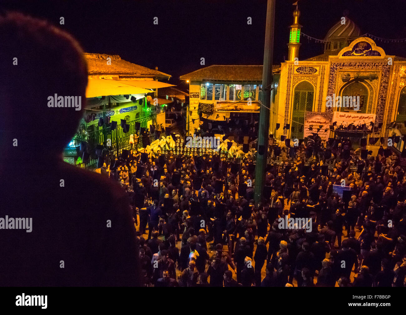 Iranian Shiite Muslim Men Mourners With An Alam In A Mosque Courtyard On Ashura, The Day Of The Death Of Imam Hussein, - Stock Image