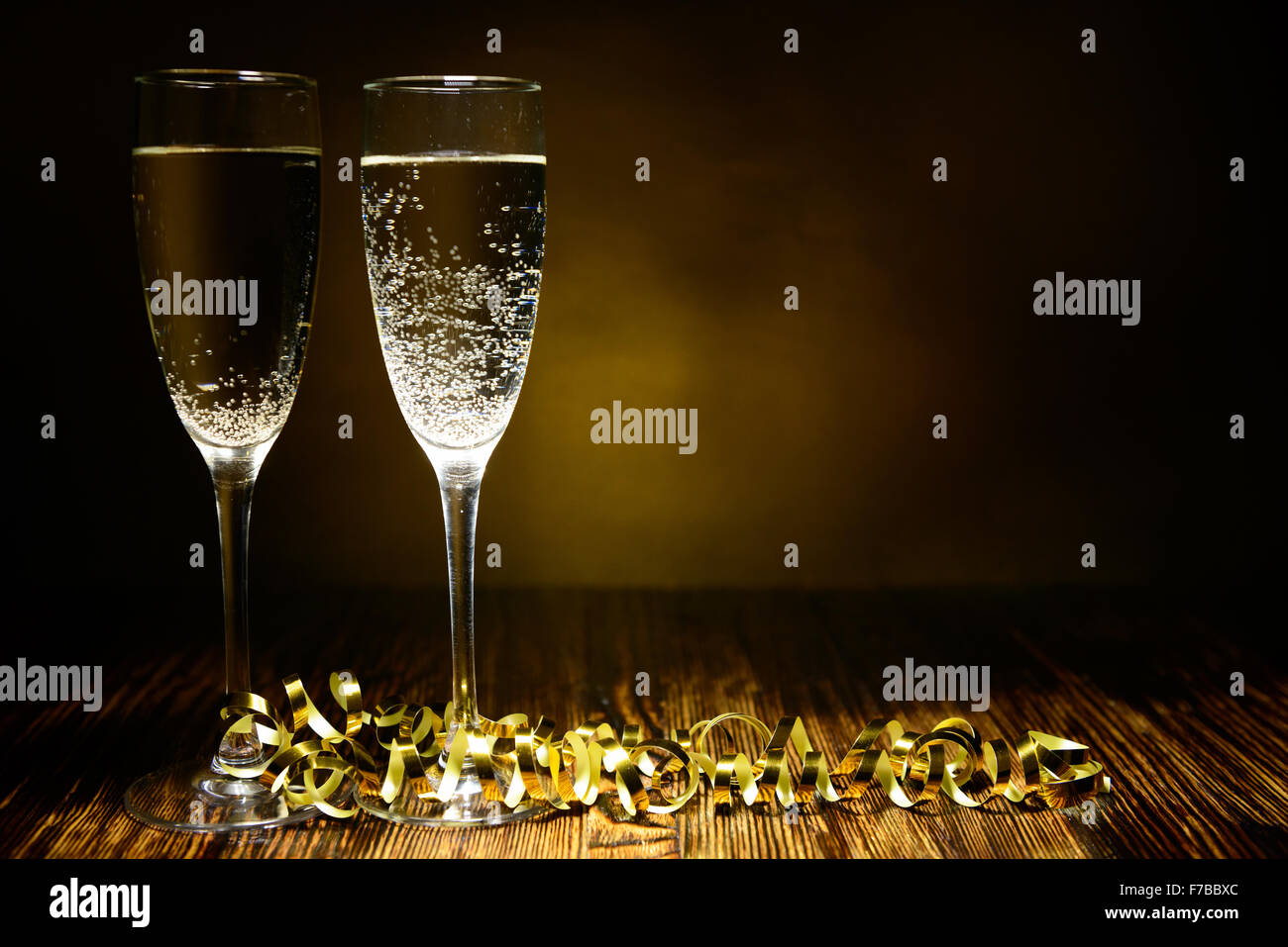 two glasses of champagne on a wooden background Stock Photo