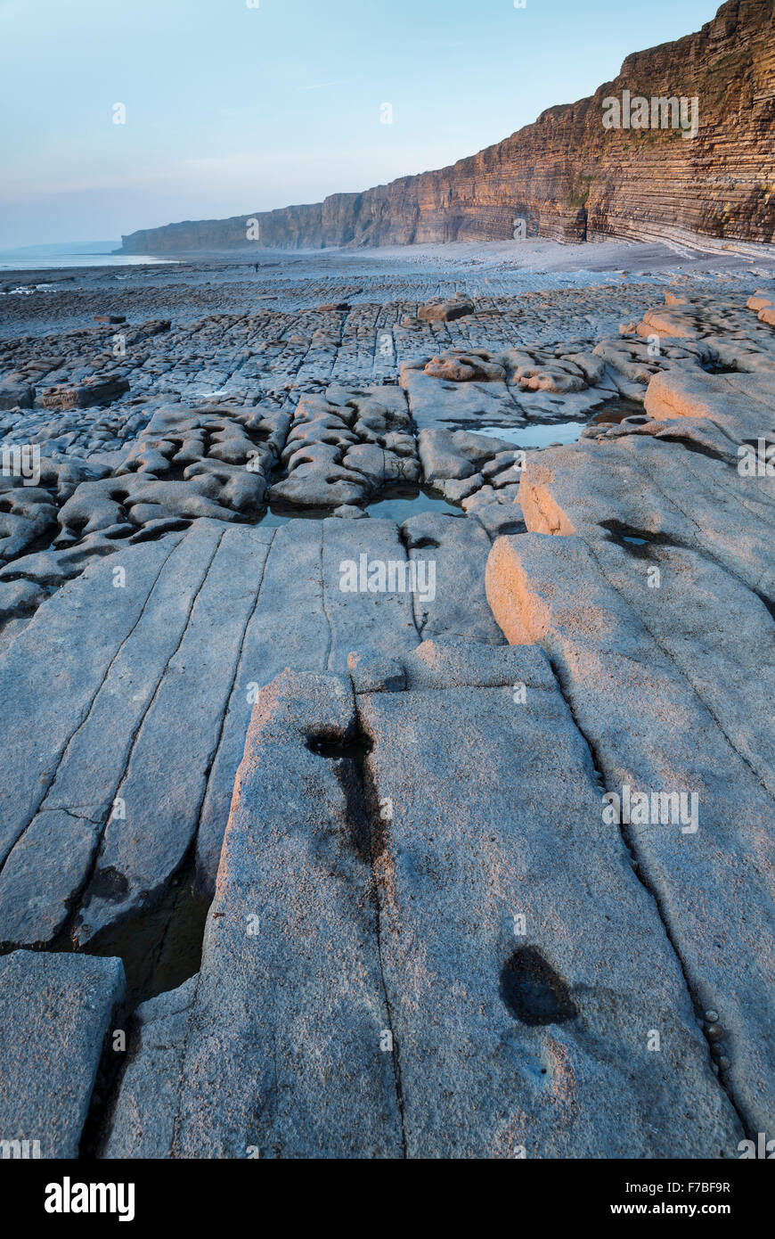 Beautiful rock Striations at low tide on an empty beach at Nash Point, Vale of Glamorgan, Wales. Stock Photo