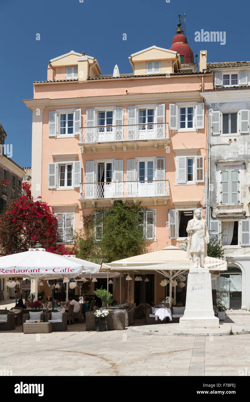 A Statue stands outside a cafe restaurant in a town square in old Corfu Town, Corfu. Stock Photo