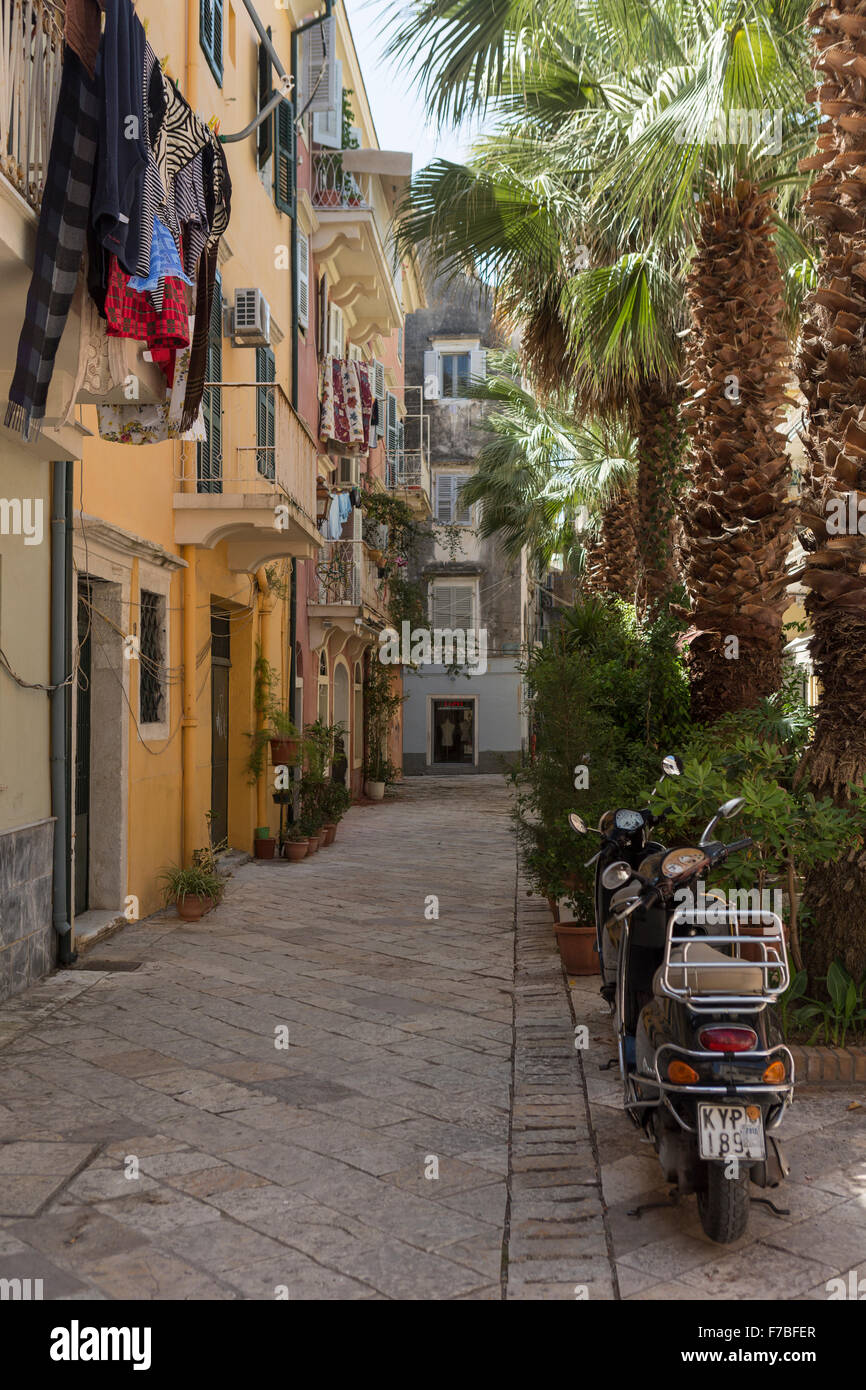 Mopeds and washing in a back street in old Corfu Town. Corfu Stock Photo
