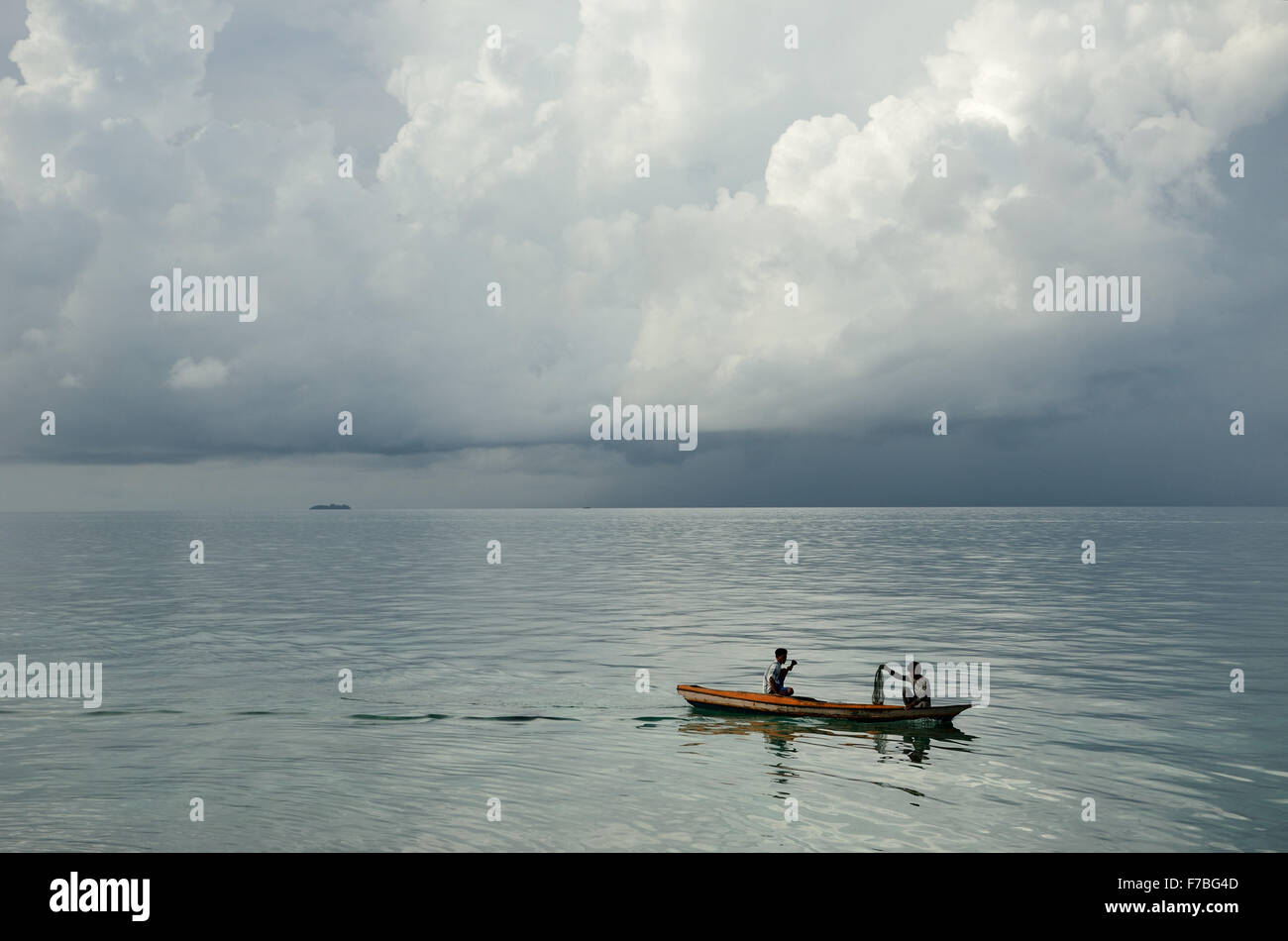 Two fishermen in the Celebes sea - Stock Image