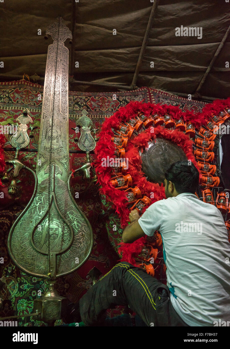 Iranian Shiite Muslim Man Making An Alam On Ashura, The Day Of The Death Of Imam Hussein, Isfahan Province, Kashan, - Stock Image