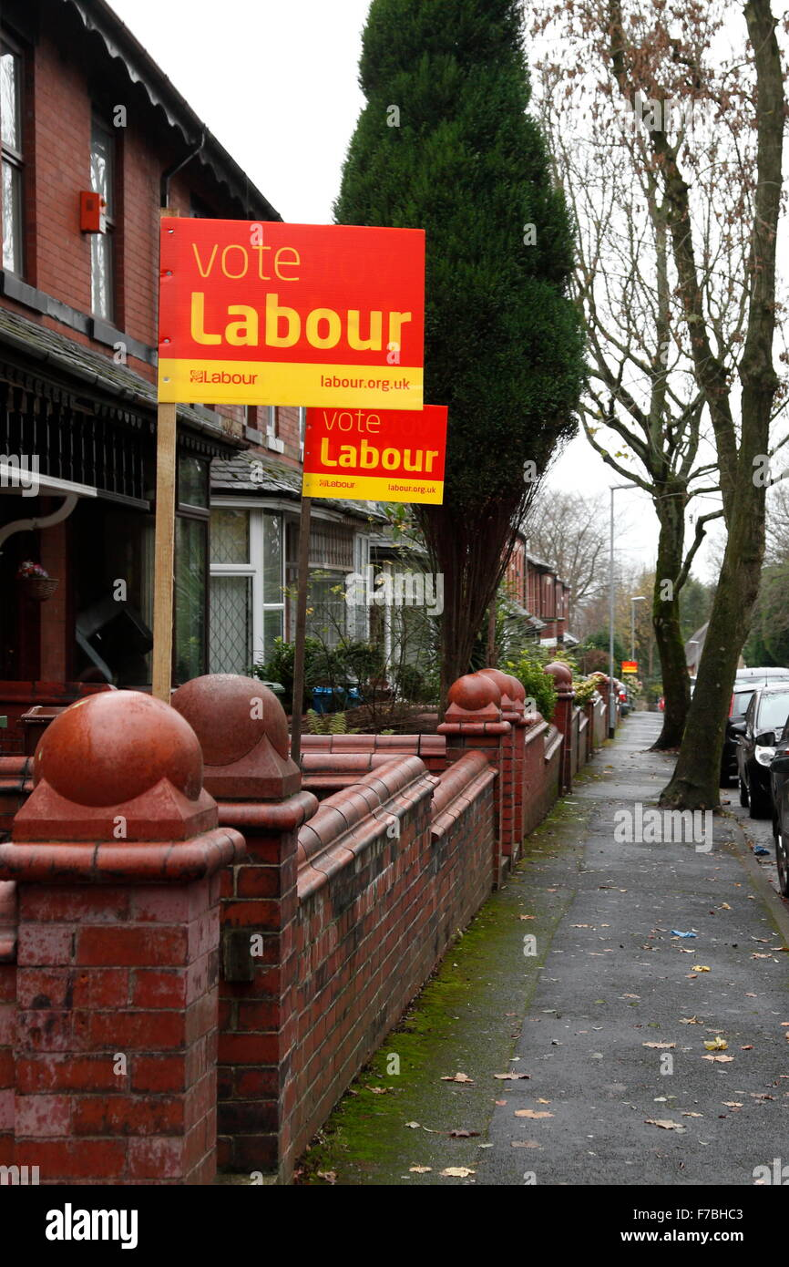Oldham, UK, 28th November 2015. Party placards supporting the Labour Party in a street in Oldham in the run up to - Stock Image