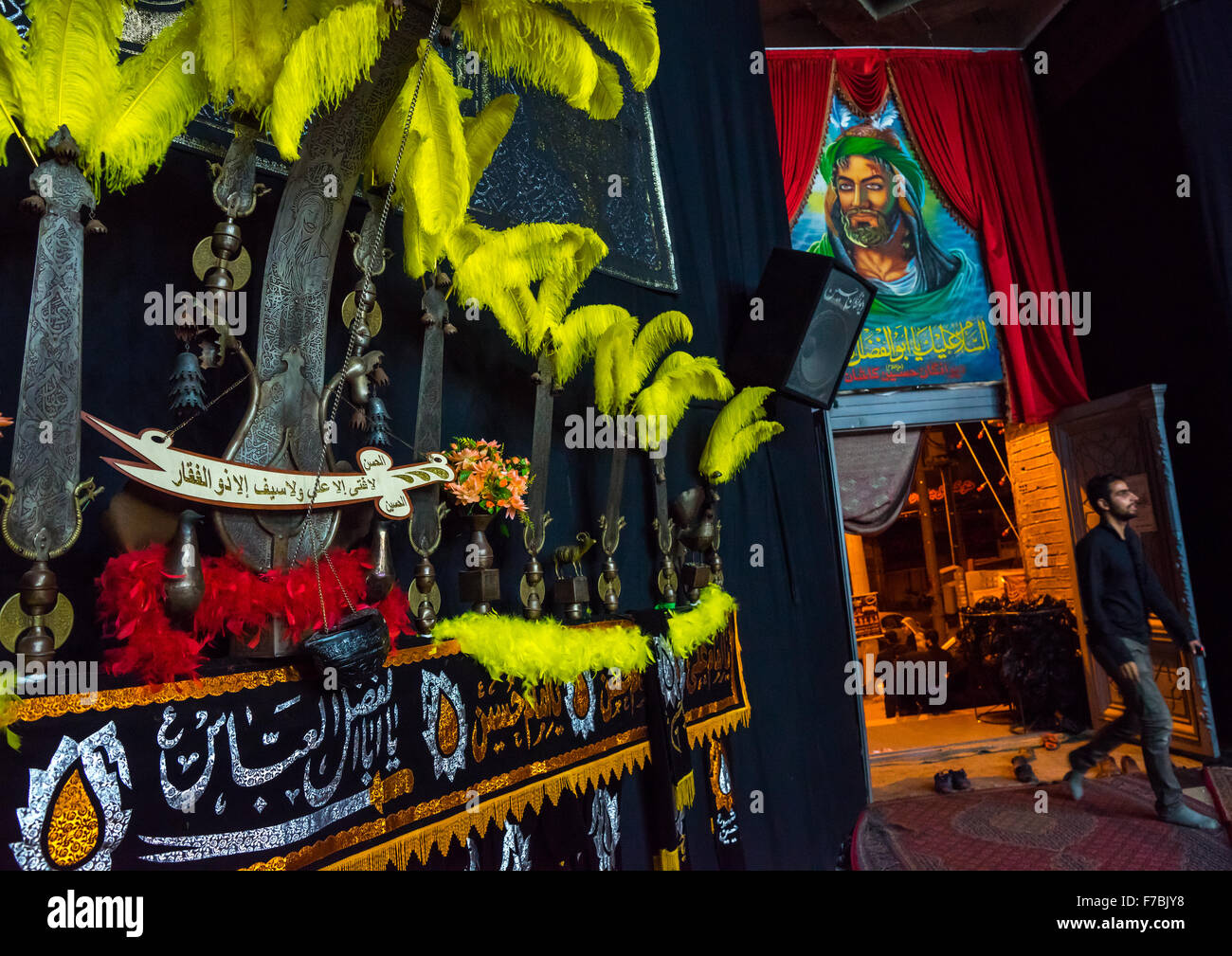 An Alam Near An Imam Hussein Portrait On Ashura, Isfahan Province, Kashan, Iran - Stock Image