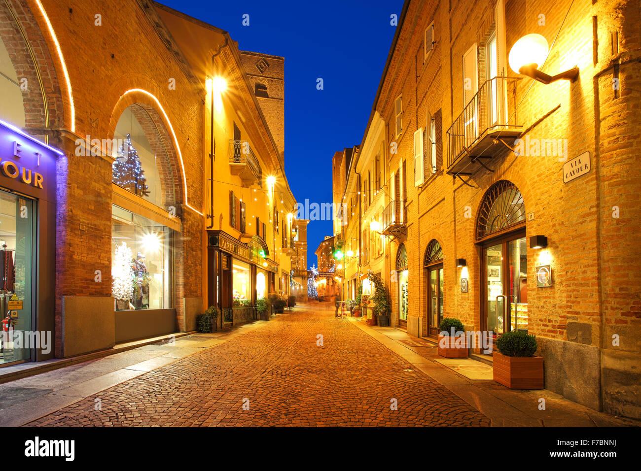 Popular tourist street in historic center of Alba, Italy. - Stock Image