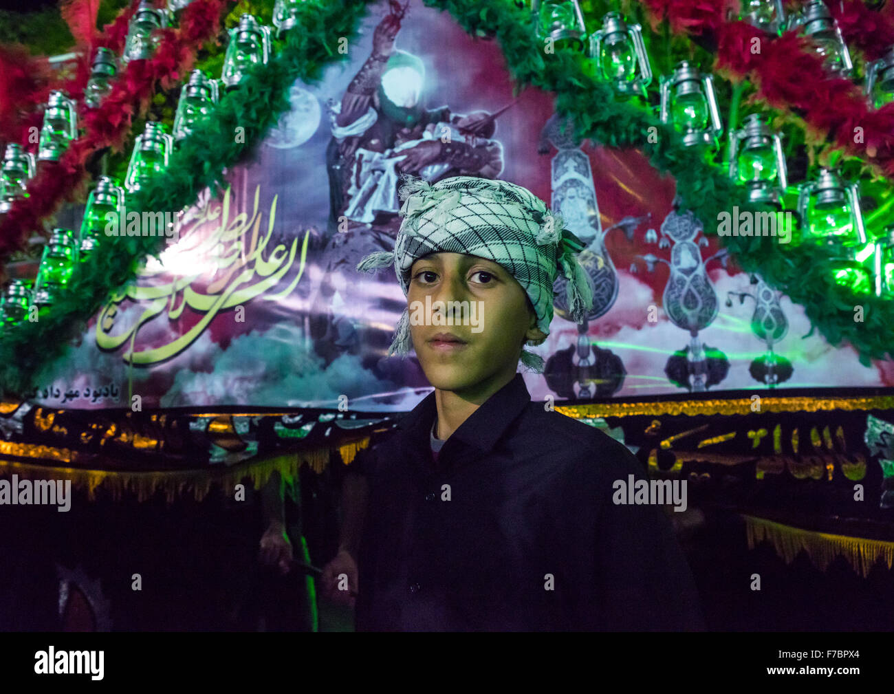 Iranian Shiite Muslim Boy Mourner Pausing Proudly In Front Of An Alam On Ashura, The Day Of The Death Of Imam Hussein, - Stock Image