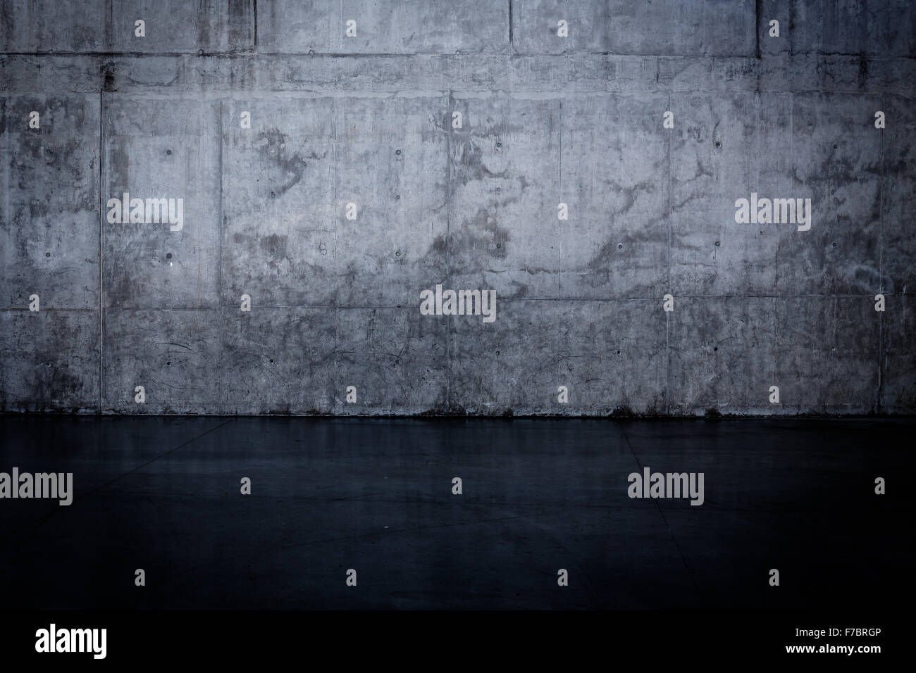 Grungy dark concrete wall and wet floor for background texture Stock