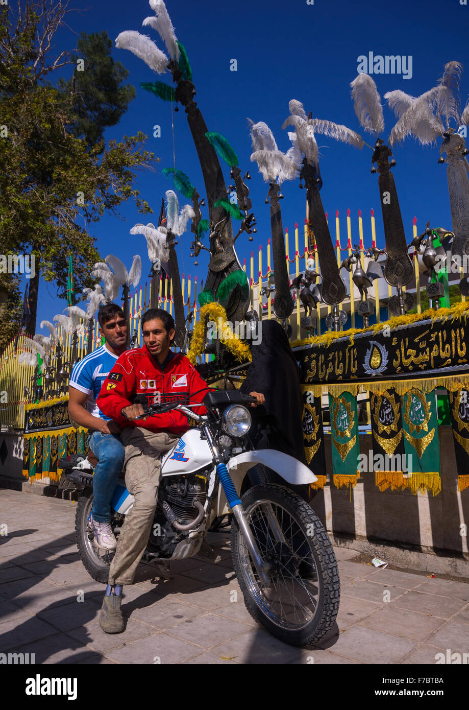 Iranian Men On Mototbike In Front Of An Alam On Tasua Celebration, Lorestan Province, Khorramabad, Iran - Stock Image