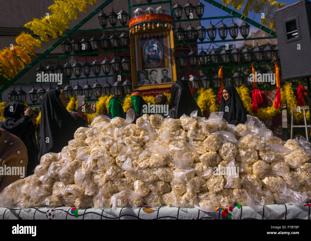 Candles For Sale In Front Of An Alam For Chehel Menbari Festival On Tasua To Commemorate The Martyrdom Anniversary - Stock Image