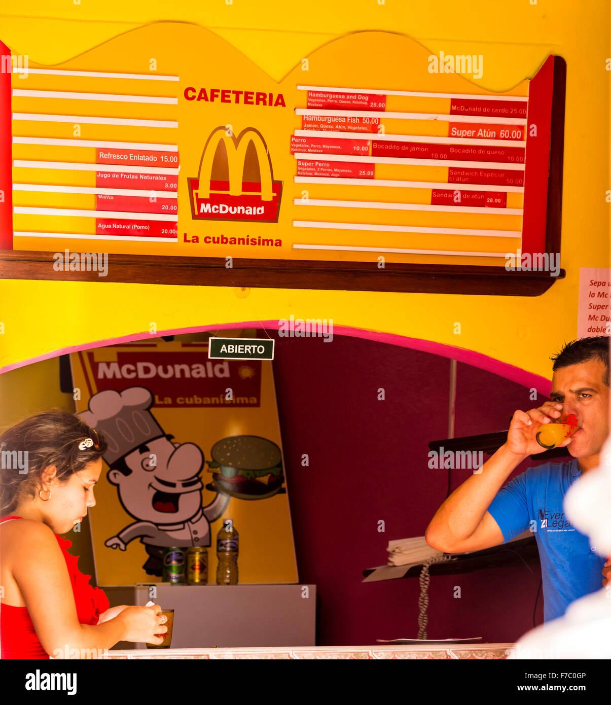 Cuban mcdonald fast food restaurant mcdonald price list family cuban mcdonald fast food restaurant mcdonald price list family father and daughter streetlife in the center of santa clara altavistaventures Images