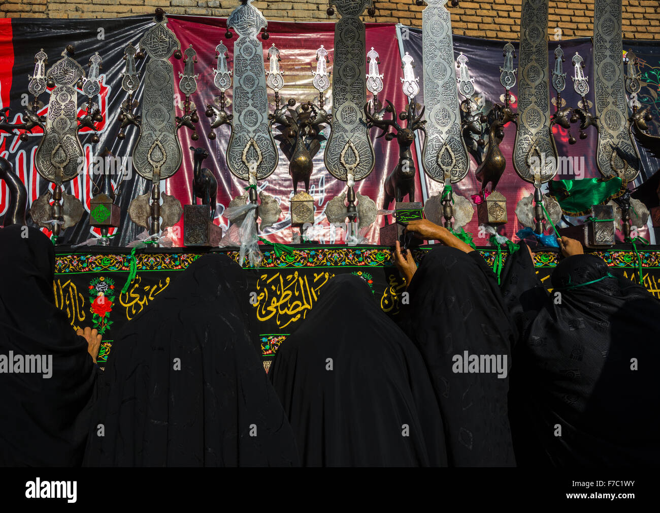 Iranian Shiite Women Putting Green Ribbons On An Alam To Make Wishes During Chehel Menbari Festival On Tasua Day, - Stock Image