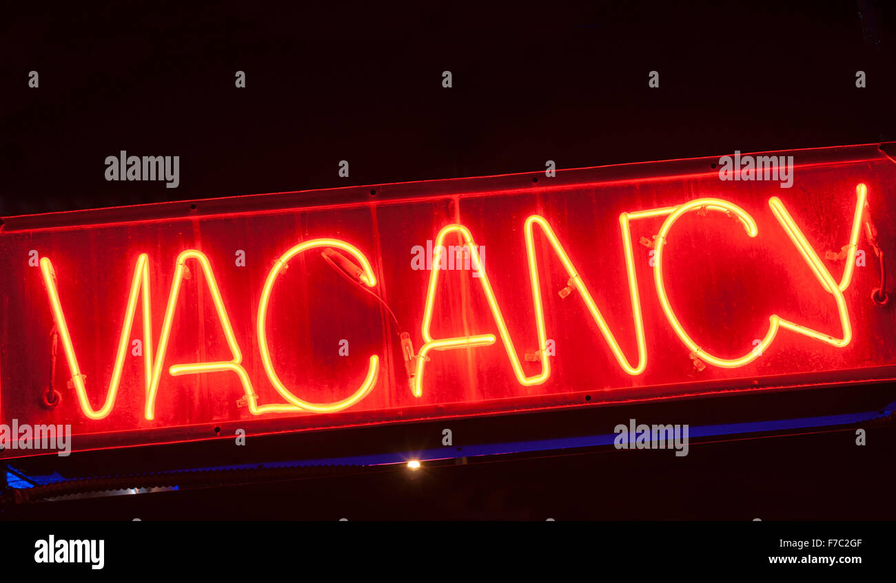red neon vacancy sign for motel at night. - Stock Image