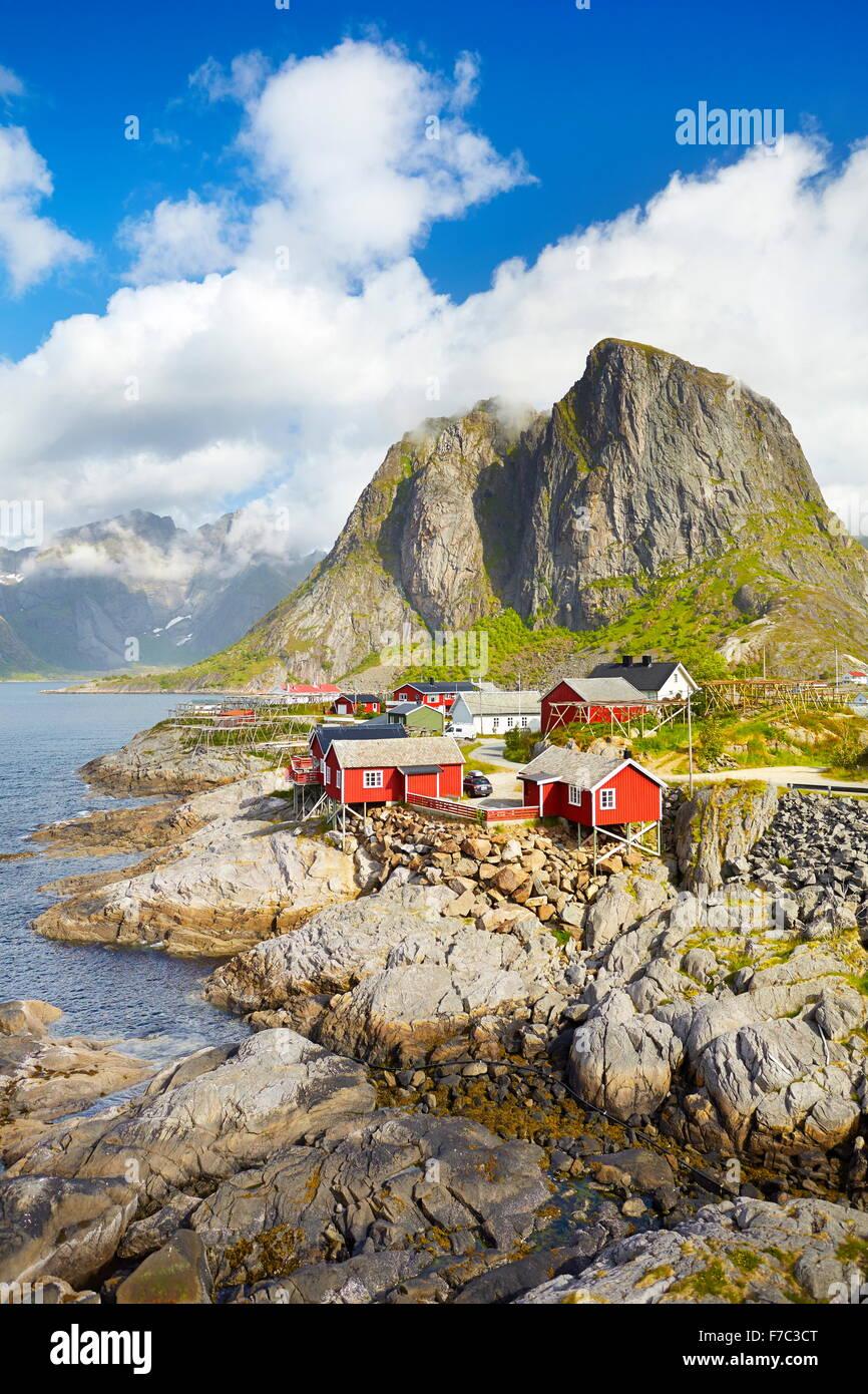 Red wooden fishermen`s huts rorbu, Lofoten Island landscape, Norway - Stock Image