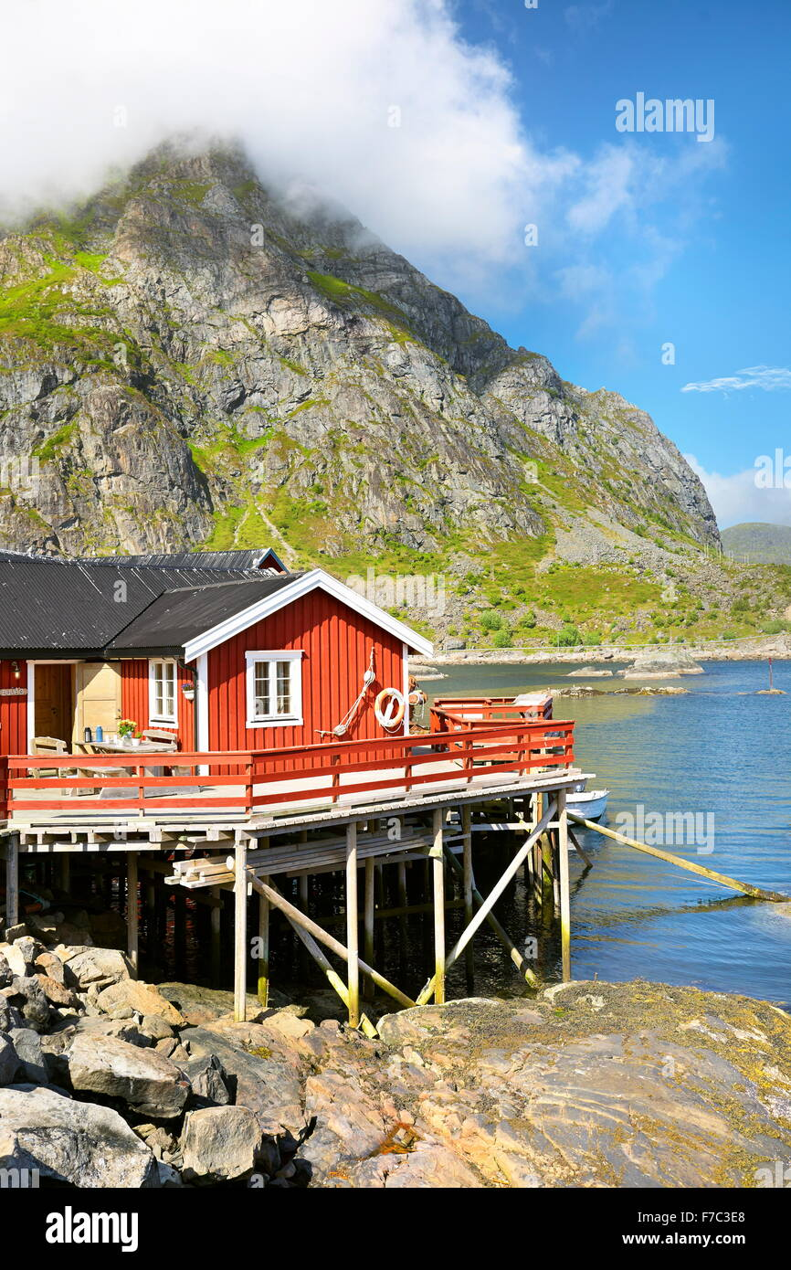 Traditional red wooden rorbu hut on Moskenesoya Island, Lofoten Islands, Norway - Stock Image