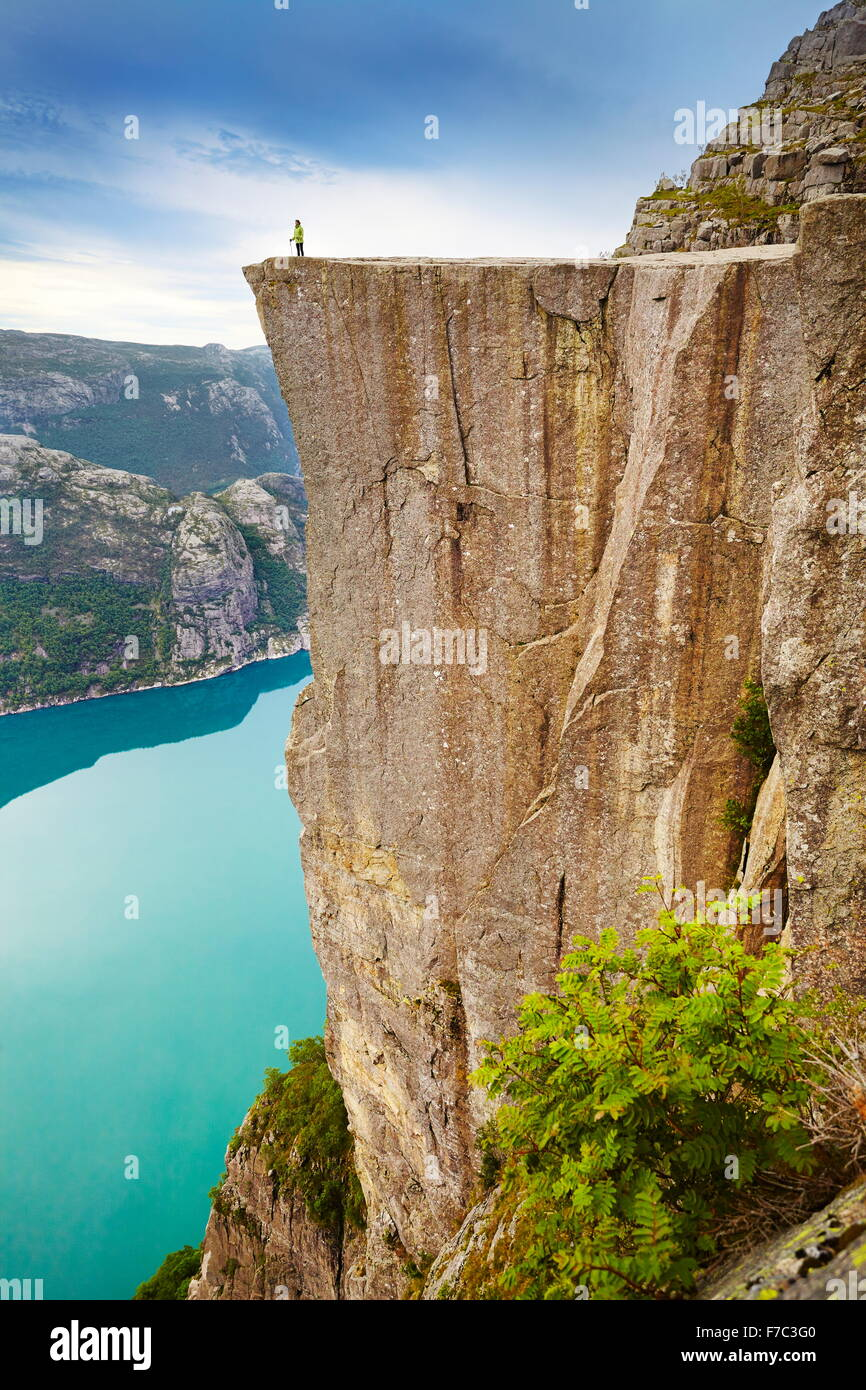 Single tourist on the Pulpit Rock landscape, Preikestolen, Lysefjorden, Norway Stock Photo