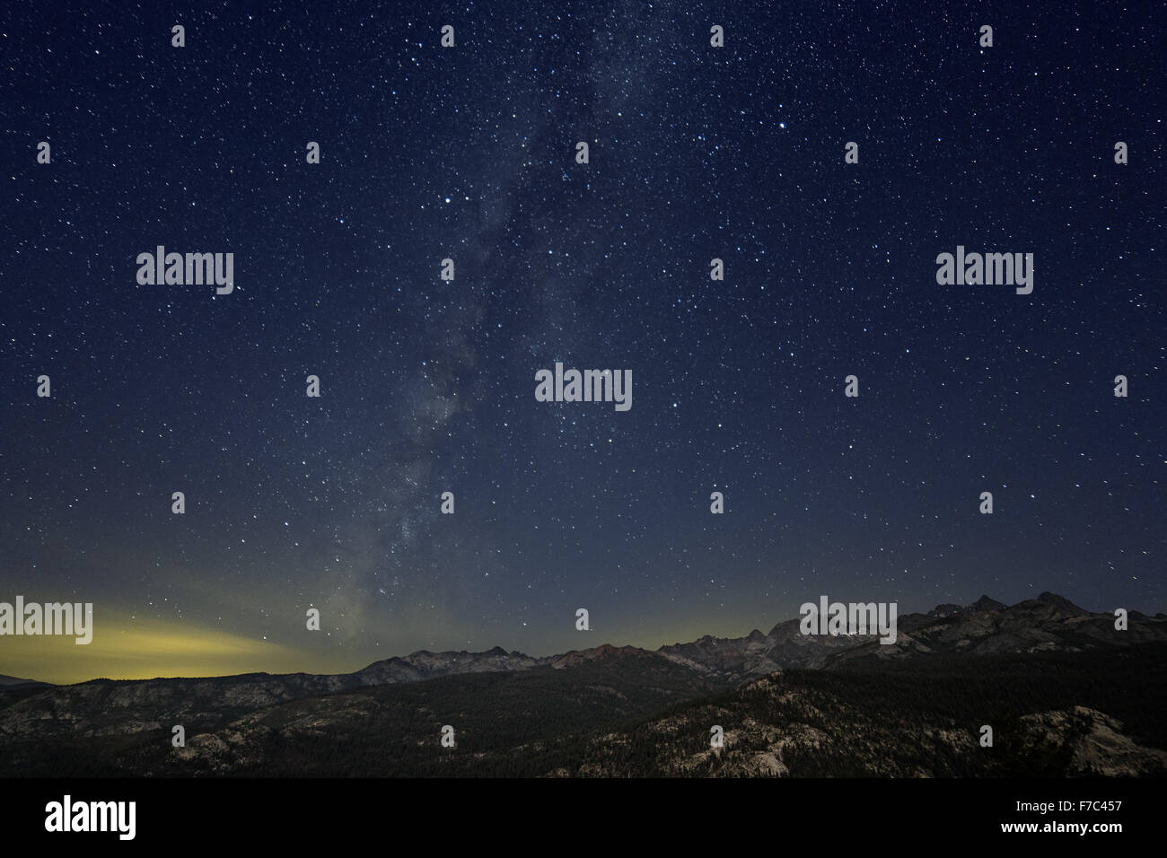 Nightscape with the Milky Way in display over the Ritter Range of the Sierra Nevada Mountains. - Stock Image