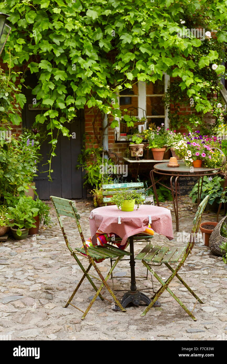 A table for two in a outdoor restaurant, Ribe Old Town, Denmark - Stock Image