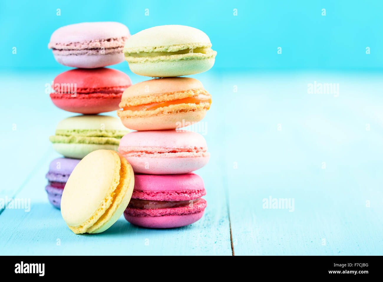 French Macaroons On Blue Background - Stock Image
