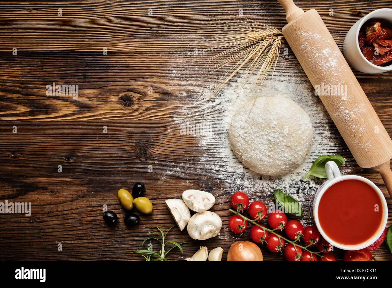 Pizza dough with ingredients on wood Stock Photo: 90632781