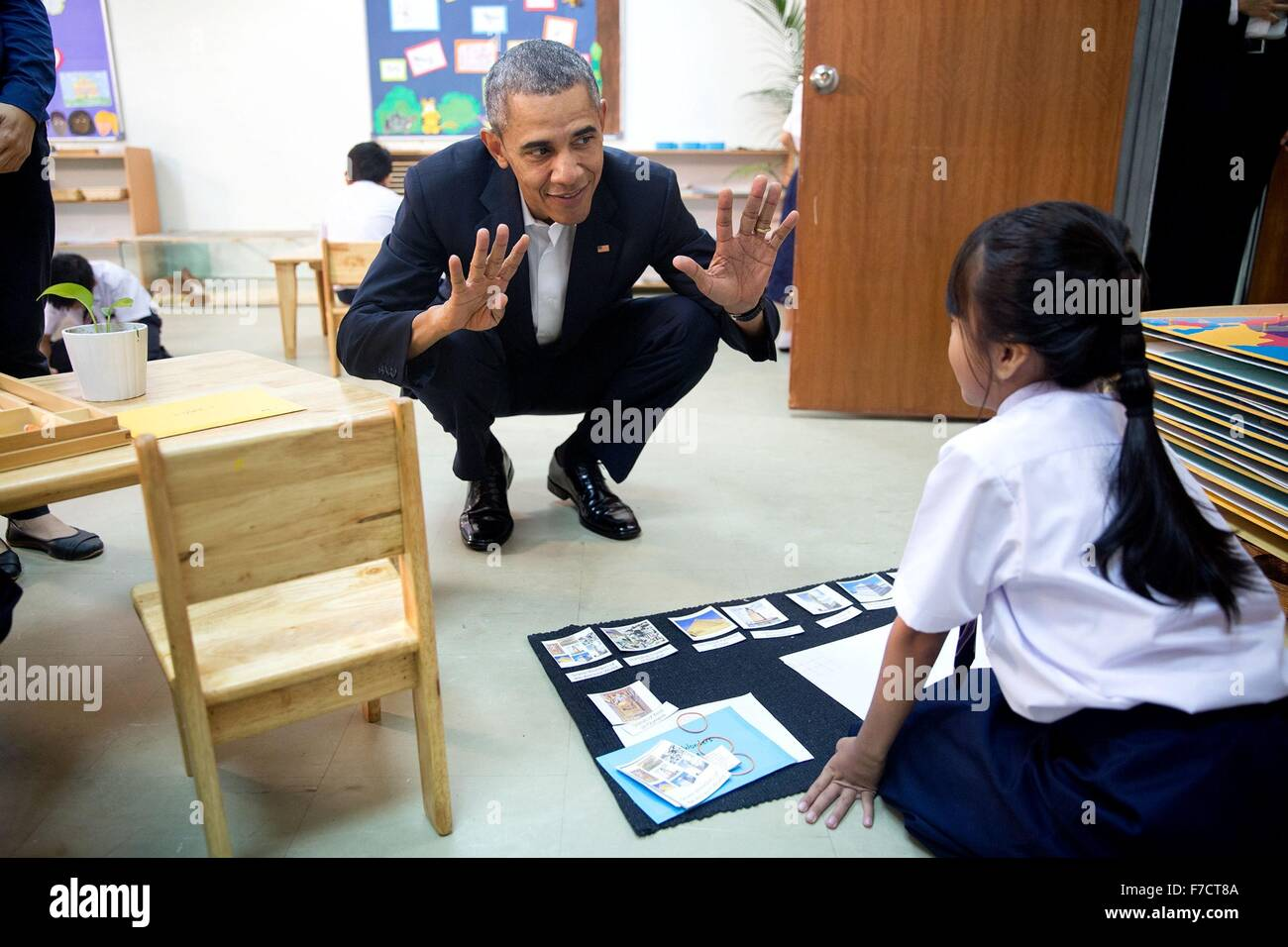 U.S. President Barack Obama talks with a young girl during a tour of the Dignity for Children Foundation November - Stock Image