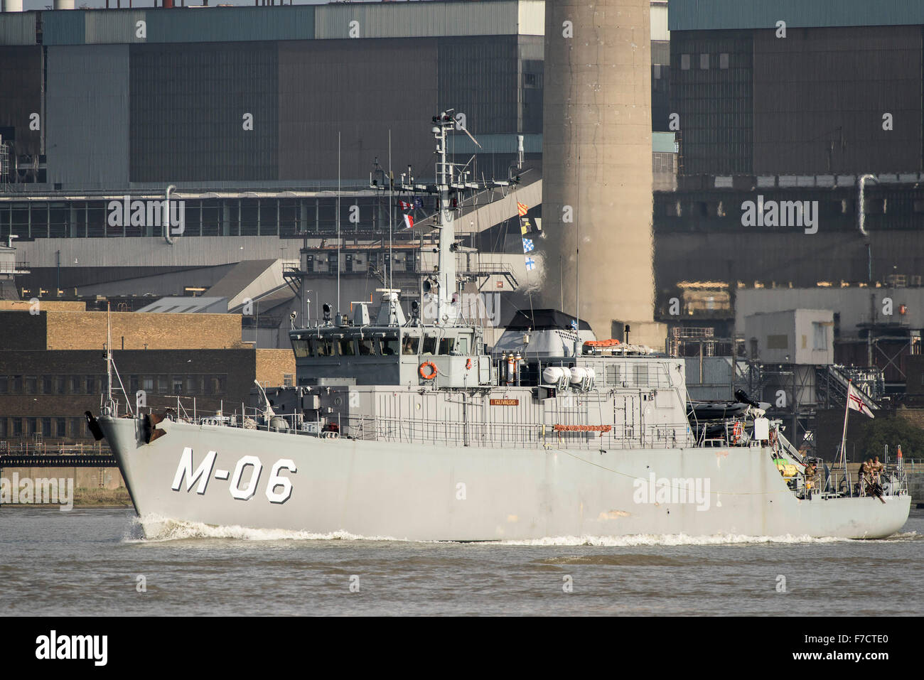 The NATO minehunter LVNS Talivaldis (M-06) steams upriver on the River Thames. - Stock Image