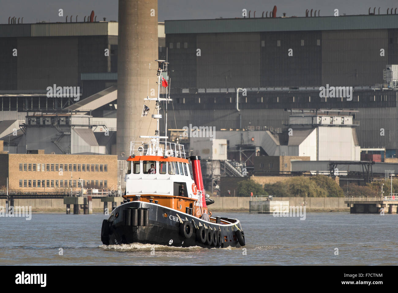 The tug Christine steaming across the River Thames. - Stock Image