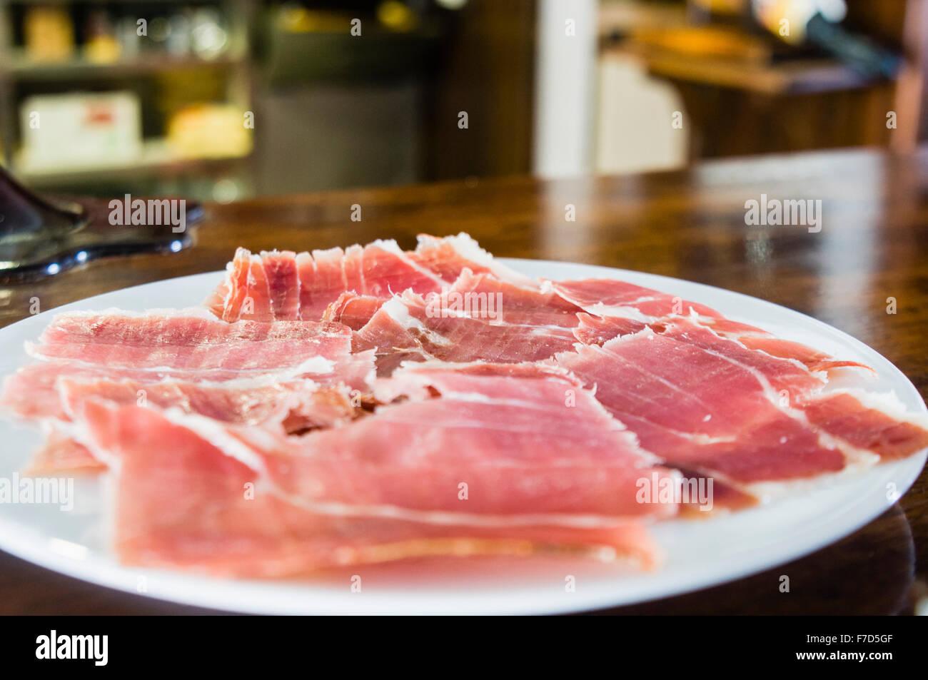 Spanish ham (Jamón ibérico, Iberian ham, pata negra) cured ham served as a tapas in a bar - Stock Image