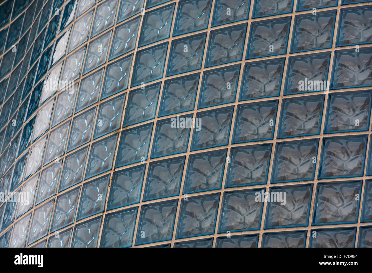 A glass brick, block background, wallpaper, pattern or texture. - Stock Image