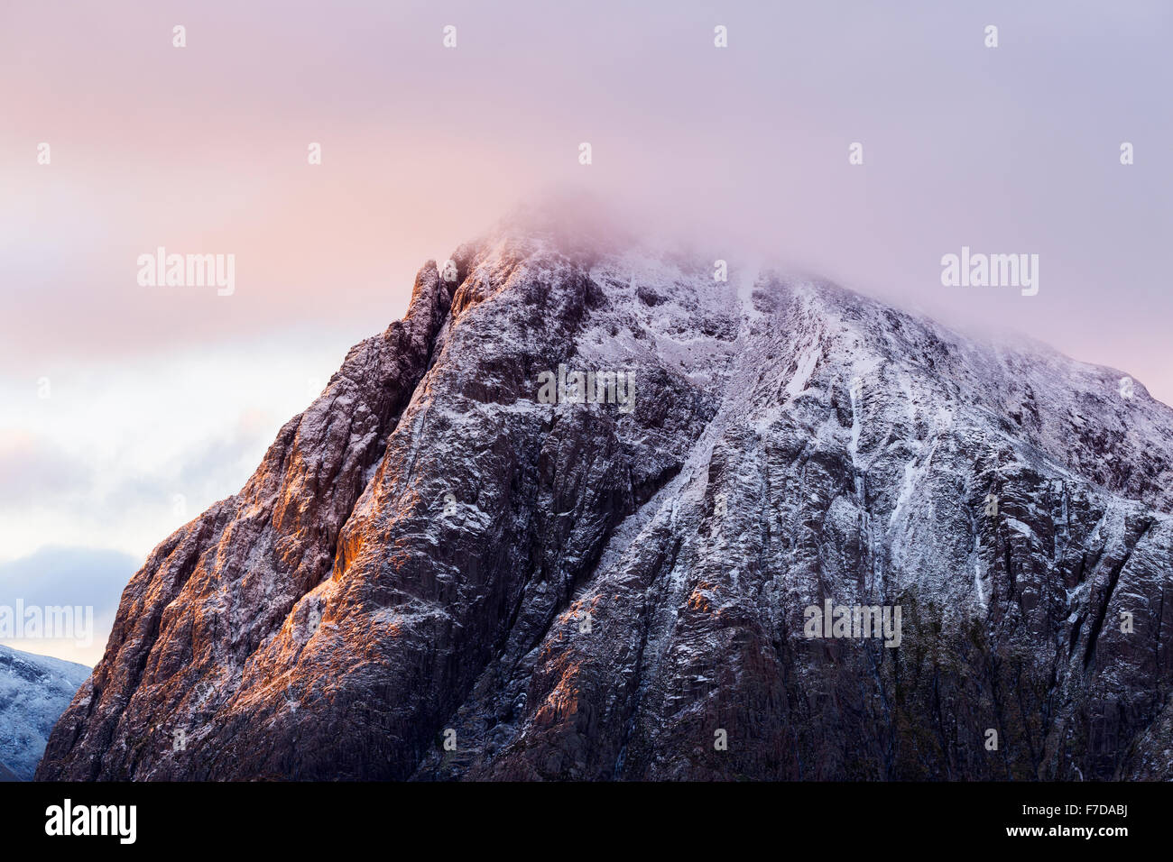 Stob Dearg (Buachaille Etive Mor) sidelit by the early morning light - Stock Image