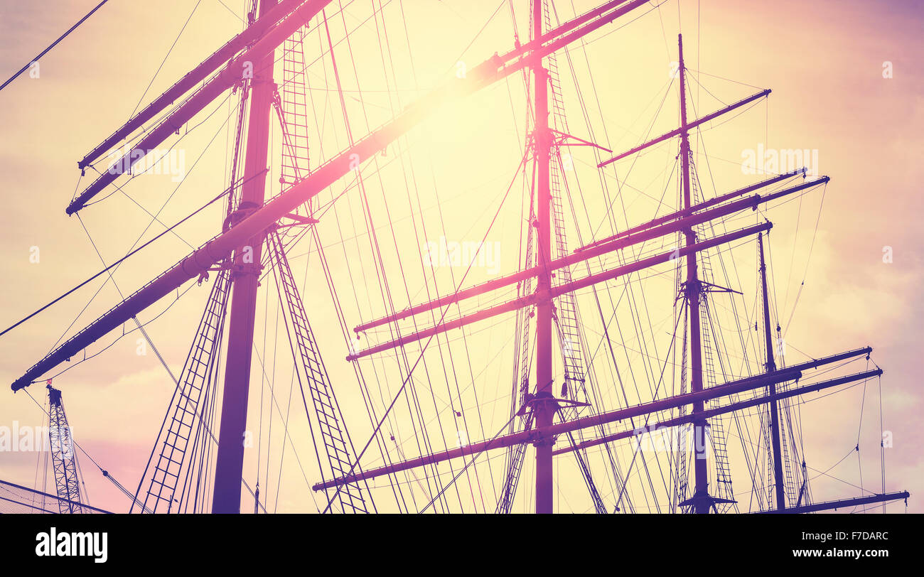 Retro vintage toned sailing masts at sunset, travel concept. - Stock Image
