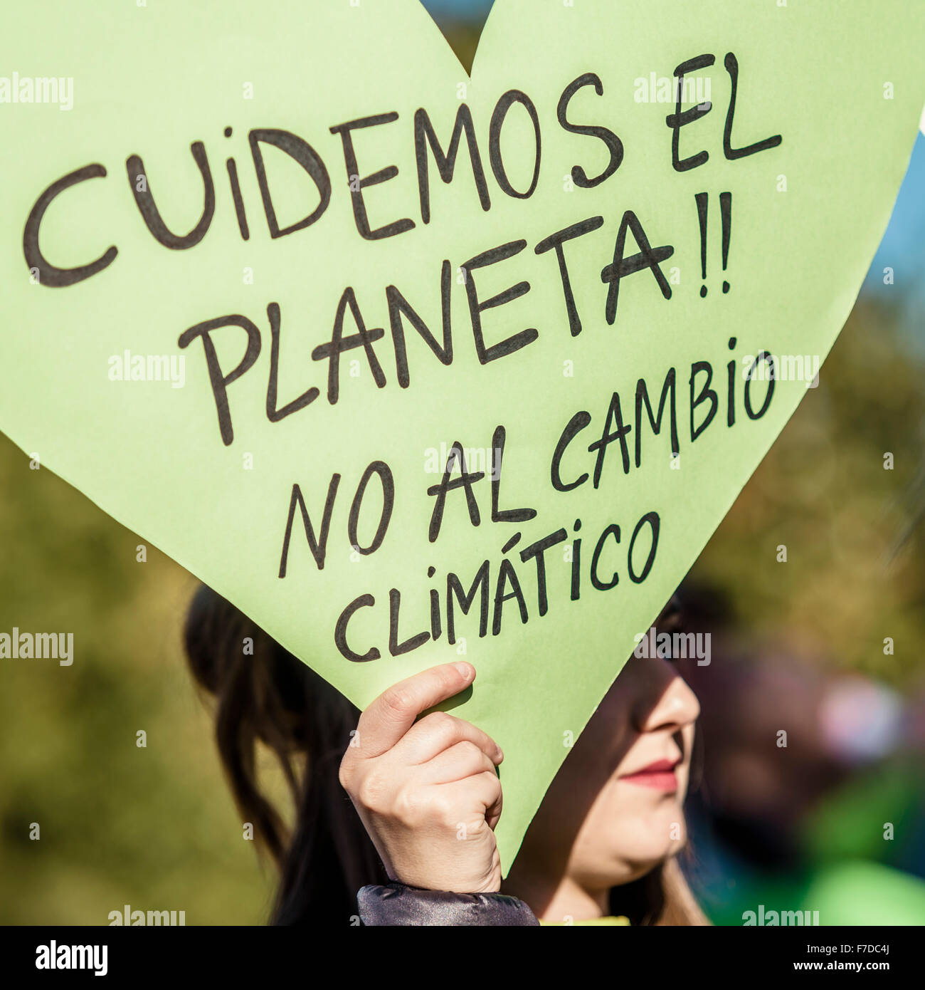 Barcelona, Spain. 29th November, 2015. A protestor against global warming holds her placard reading 'Lets take - Stock Image