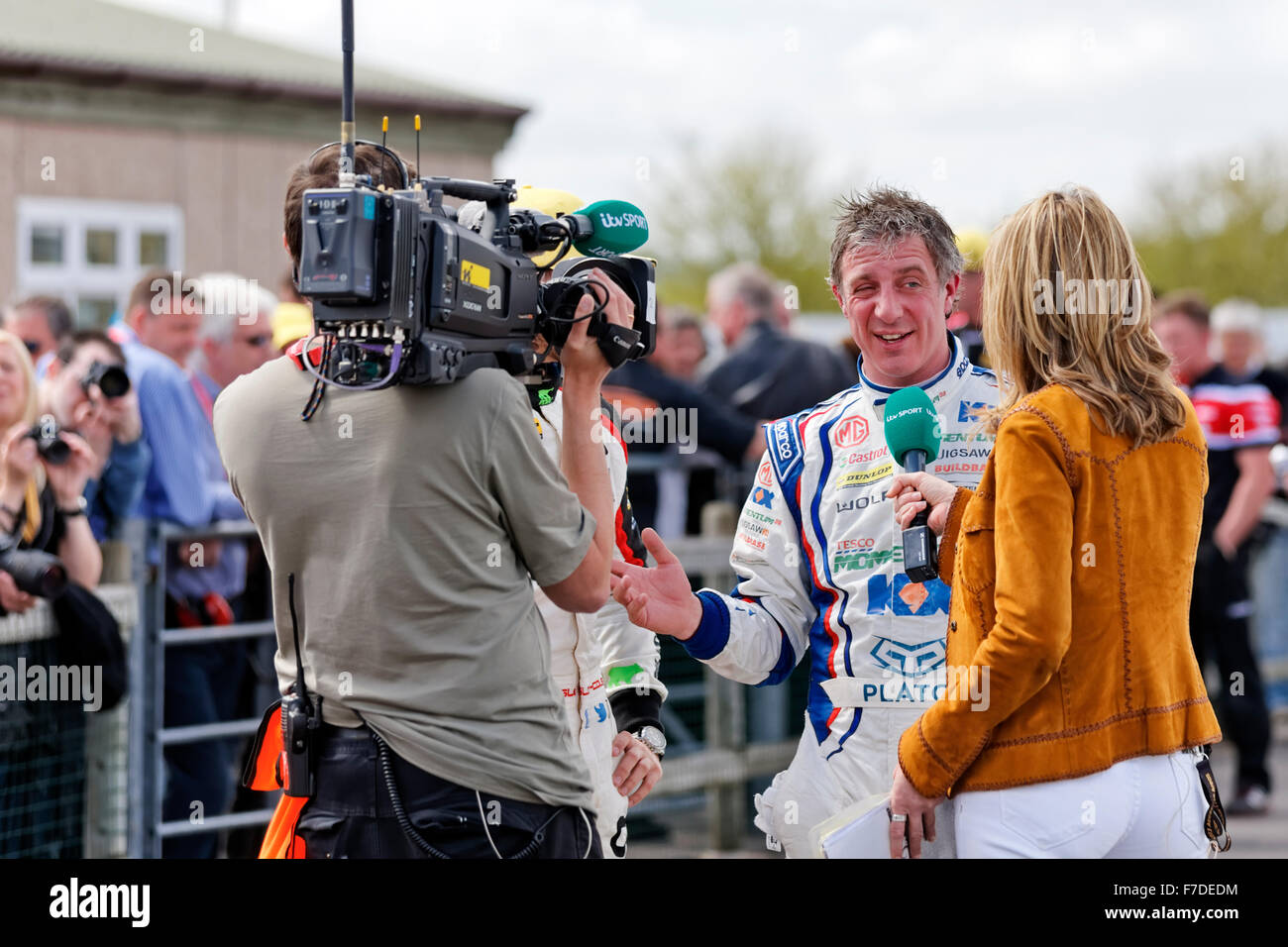 British Touring car racing driver Jason Plato being  interviewed at Thruxton race circuit by itv sports commentator - Stock Image