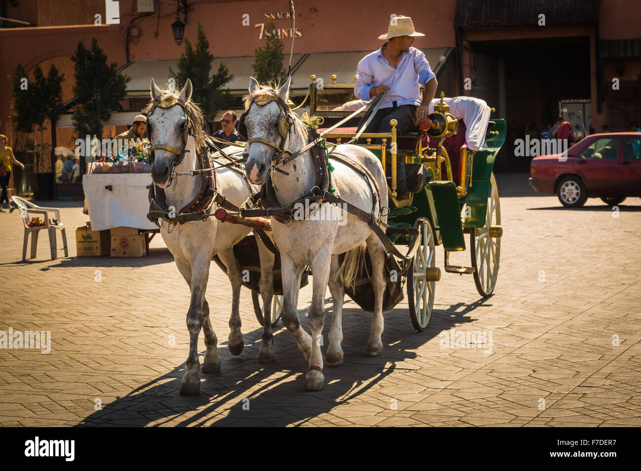 Horse carriage for tourists on Jemaa el Fna square in Marrakesh Stock Photo