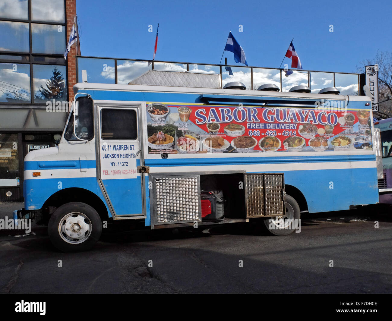 An Ecuadorian food truck parked in the shadows of the #7 elevated train on Warren Street off Roosevelt Ave. in Queens, - Stock Image