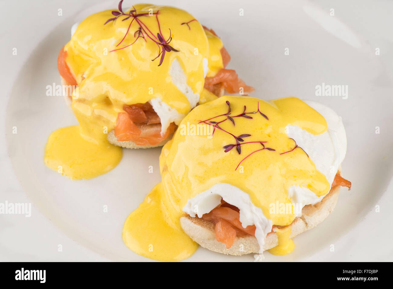 Eggs Royale breakfast consisting of an English muffin, smoked salmon and eggs with hollandaise sauce served on a - Stock Image