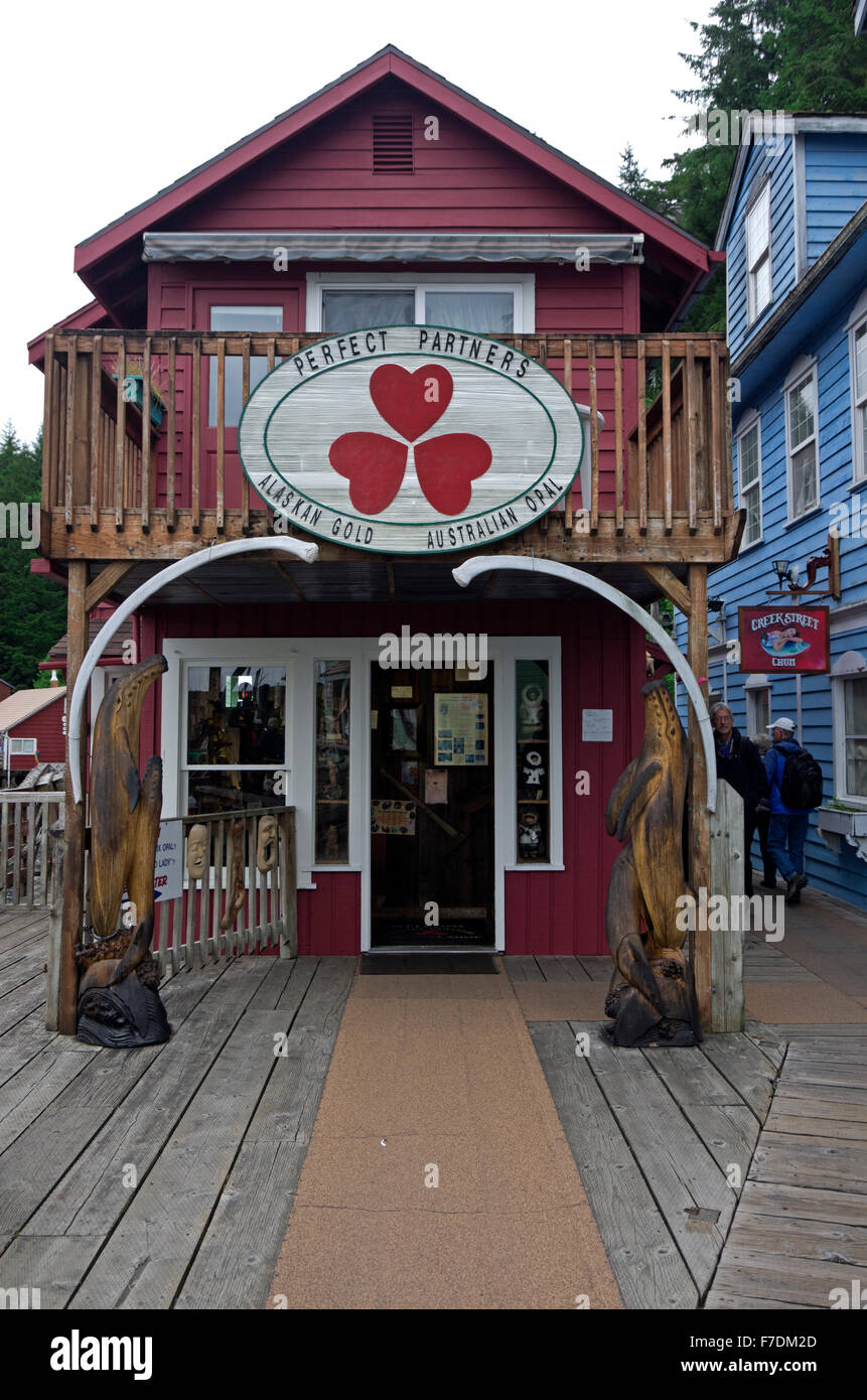 Tourist enjoy a visit to the boardwalk on Creek Street.  Gold and souvenir shops reside in remodeled houses of prostitution. Stock Photo