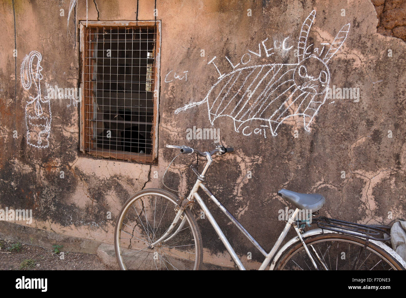 A child's chalk drawings on side of mud house, Saakpuli village, northern Ghana - Stock Image