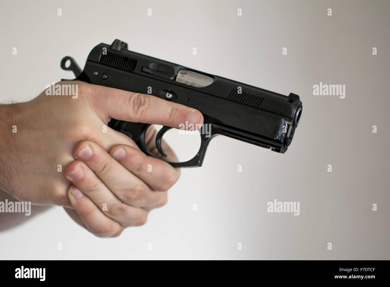Man drawing handgun in self defense - Stock Image