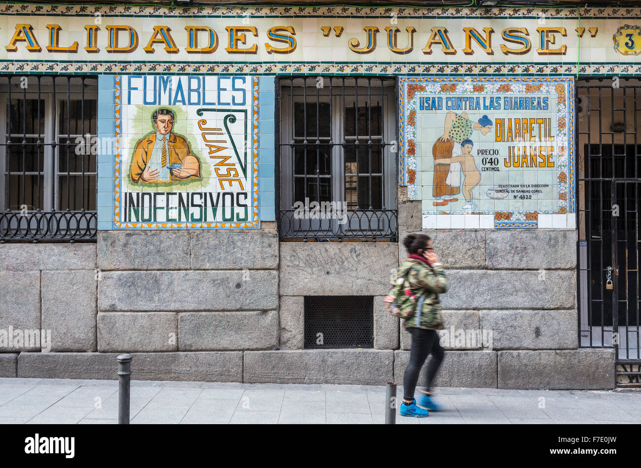 Old tiled advertising on a chemist shop in the Malasana disrict, central Madrid, Spain - Stock Image