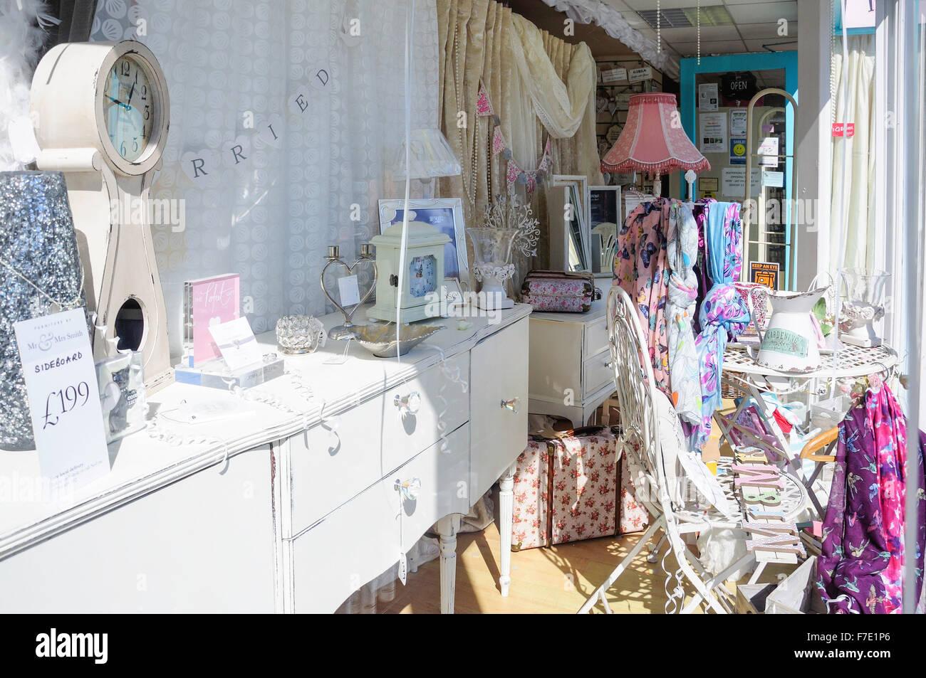 Window display of furnishing store, High Street, Rayleigh, Essex, England, United Kingdom - Stock Image