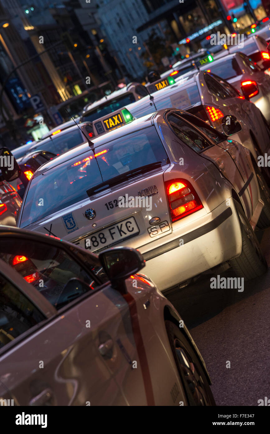 Spanish taxi cabs on the Gran via at night,, central Madrid, Spain. - Stock Image