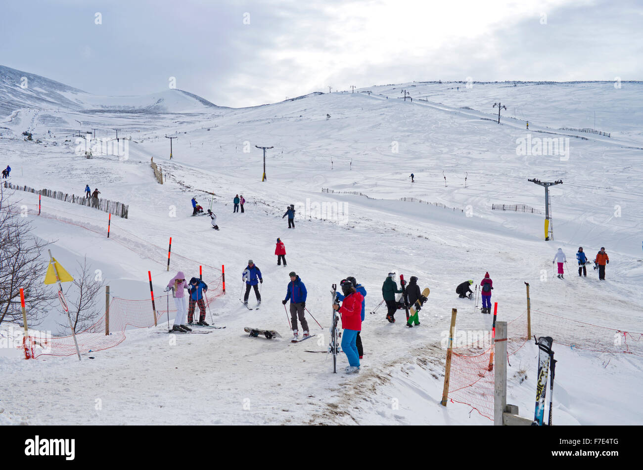 skiers and snowboarders on the lower slopes of cairngorm mountain
