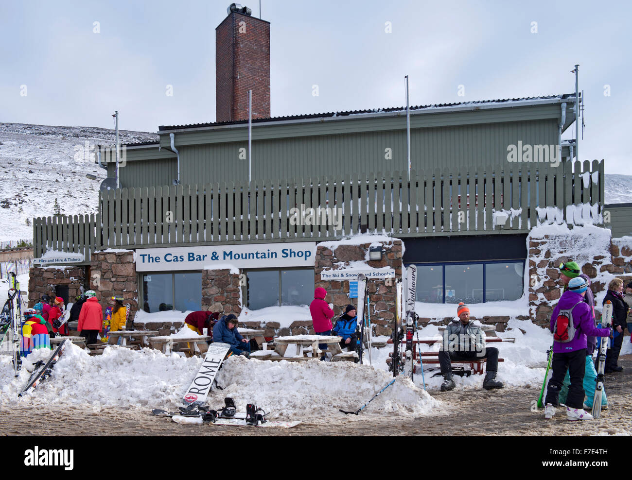 Skiers and snowboarders outside the Cas Bar and Mountain shop at Cairngorm Mountain Ski Centre,  Scottish Highland, - Stock Image
