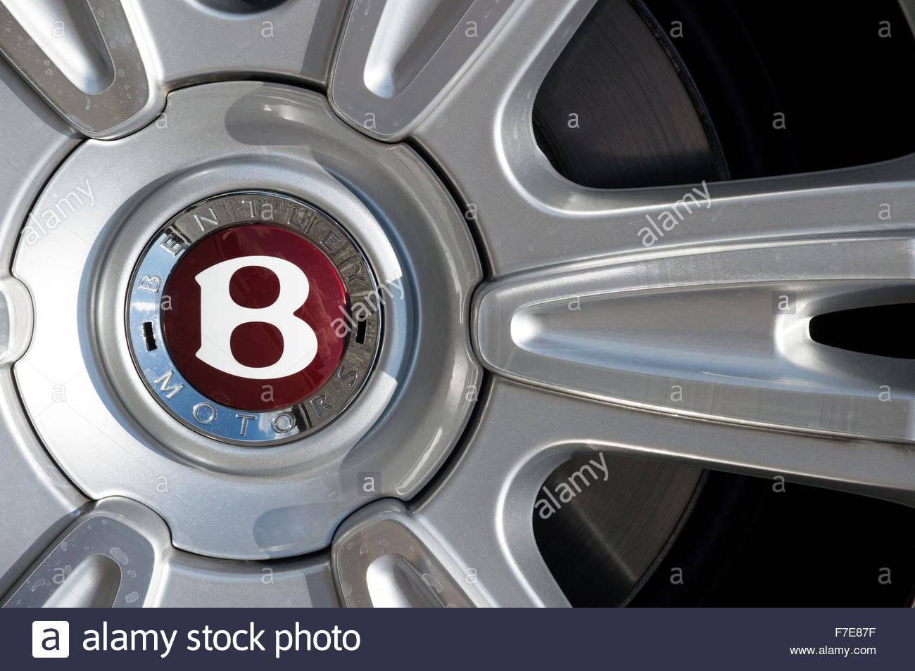 Close-up images of a Bentley Motors alloy wheel hub badge - Stock Image