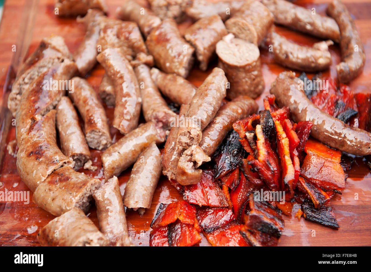 Traditional South African Boerwors sausage cooks on a Braai, or South African barbecue..  Durban South Africa. - Stock Image