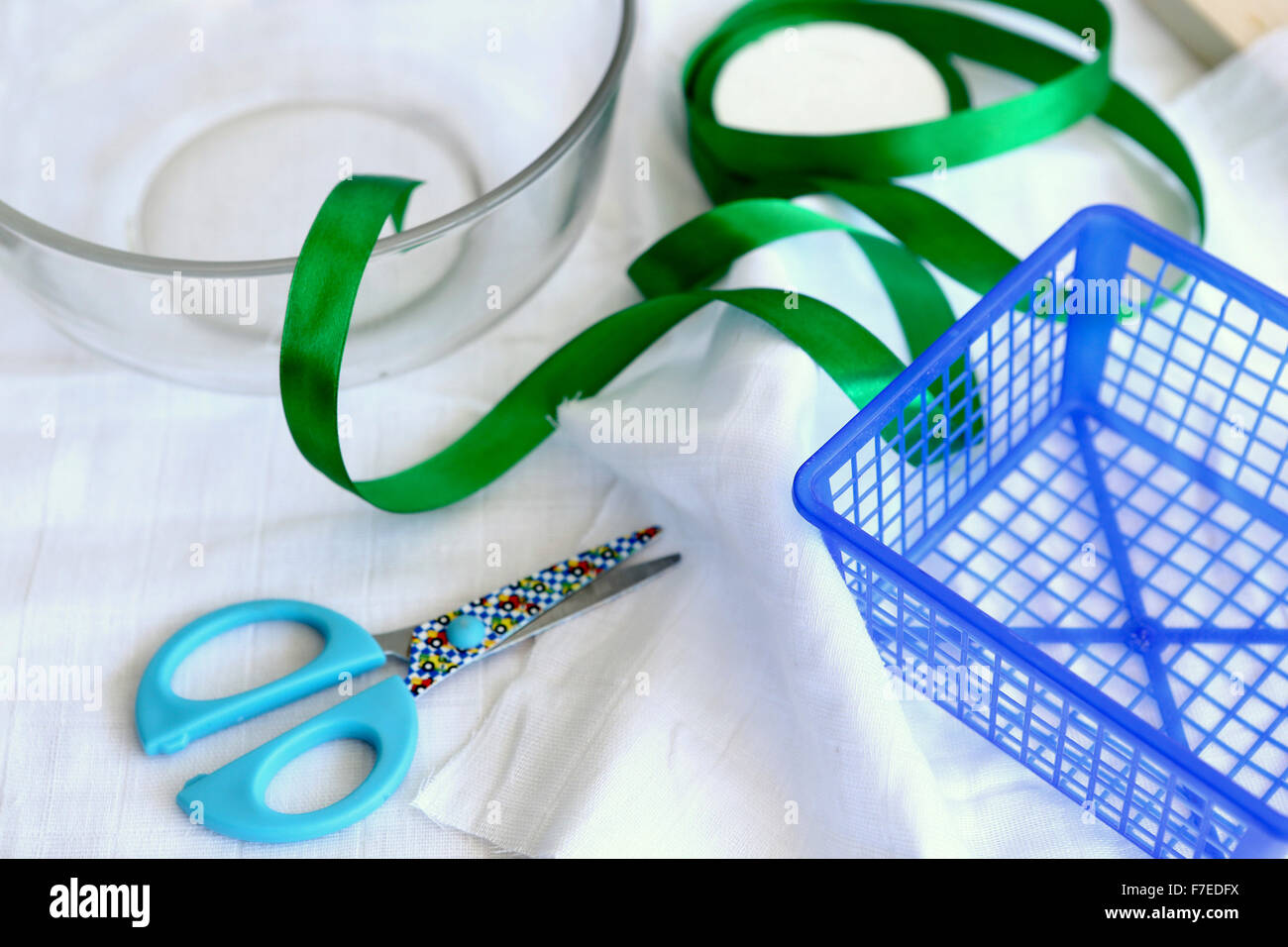 Handcraft concept with scissors basket and ribbon This image has a restriction for licensing in Israel - Stock Image