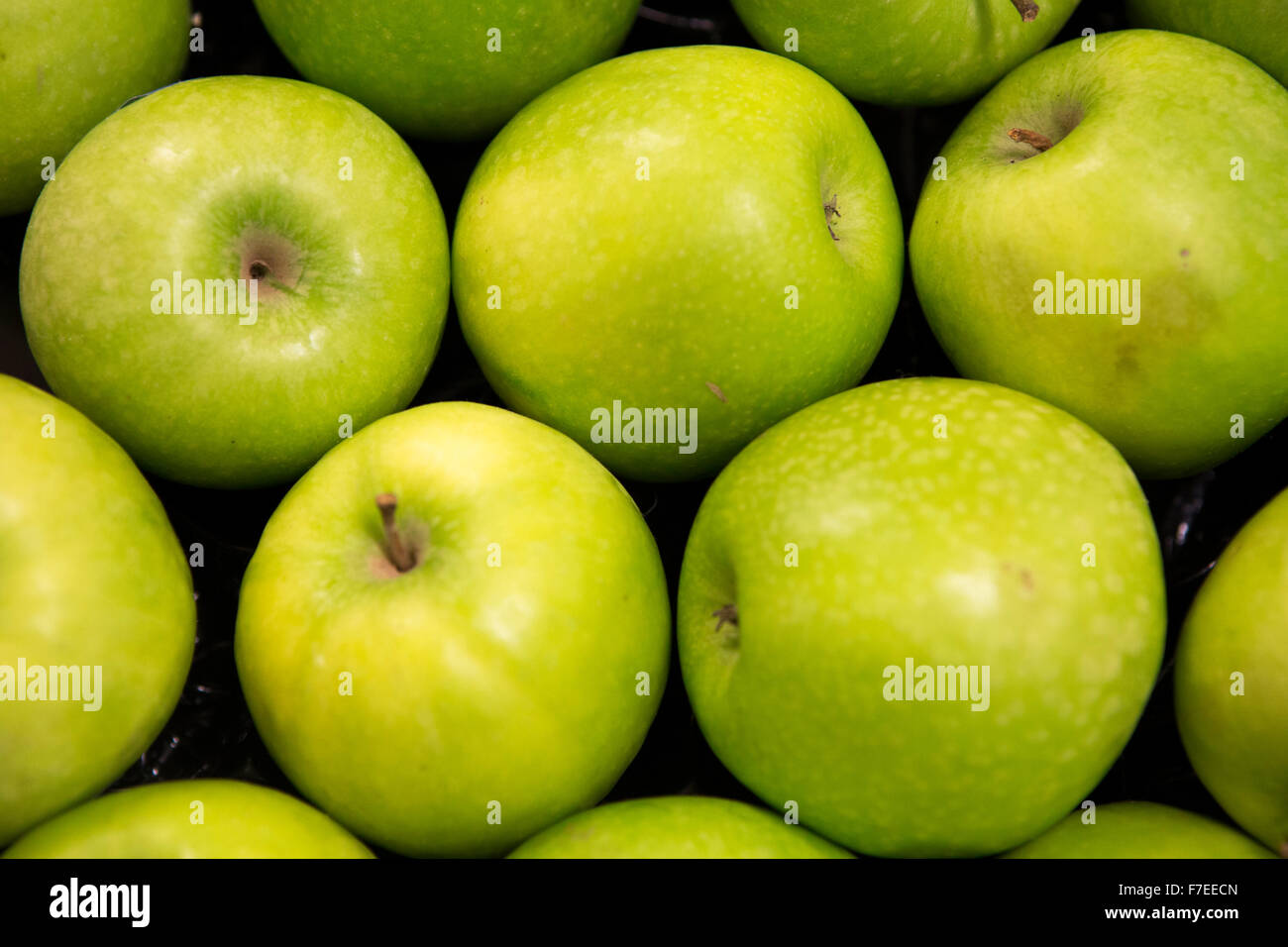 green apples for sale in a supermarket - Stock Image